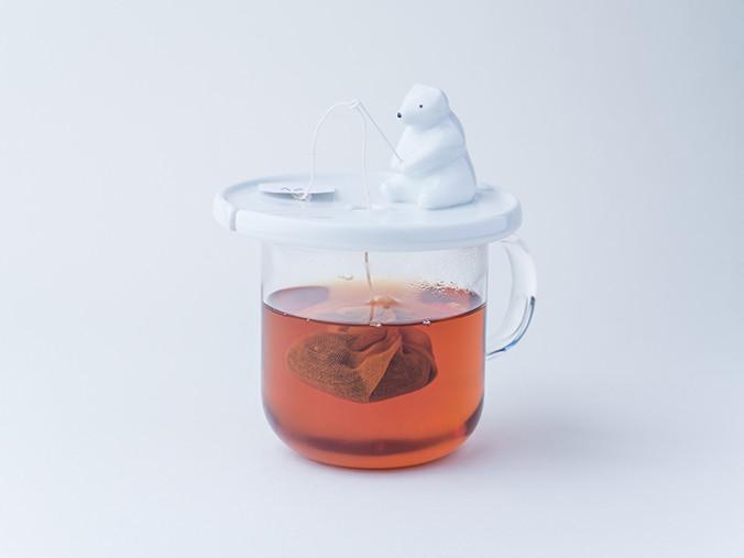L'Ours pêcheur de sachet de thé Shirokuma de Necktie